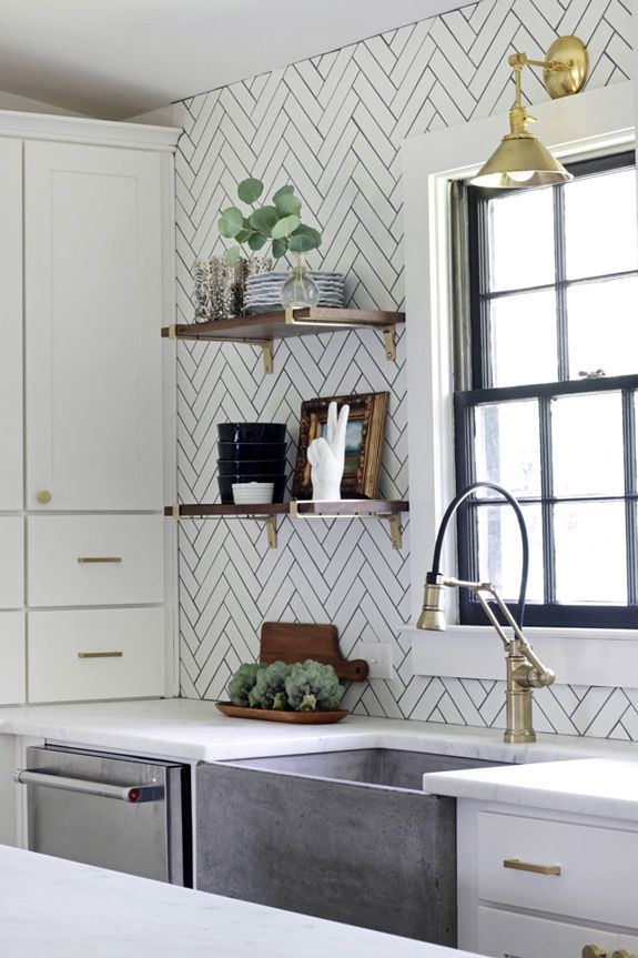Love the touches of gold and dark wood. Although I'd probably break all my sides if I had a concrete sink.