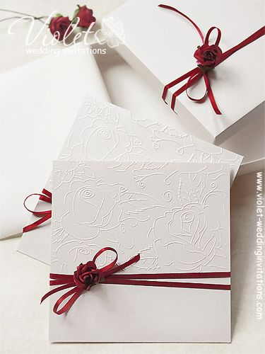 Stylish embossed dark red rose wedding invitation in a box from www.violet-weddinginvitations.com #invitations #rose #burgundy #box #wedding
