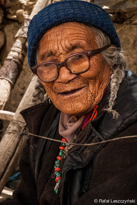 Old tibetan lady wearing glasses with deep wrinkles chanting mantras in the shade under the tree in a village of Lamayuru in Ladakh, India. This fine art photograph was made by Rafal Leszczynski in 2009.  travel / art / boho / asian / photo / print / wall decor  https://www.etsy.com/listing/218041266/old-tibetan-lady-wearing-glasses-with