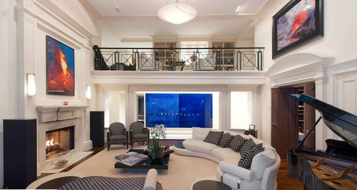 living room with view of library on mezzanine level
