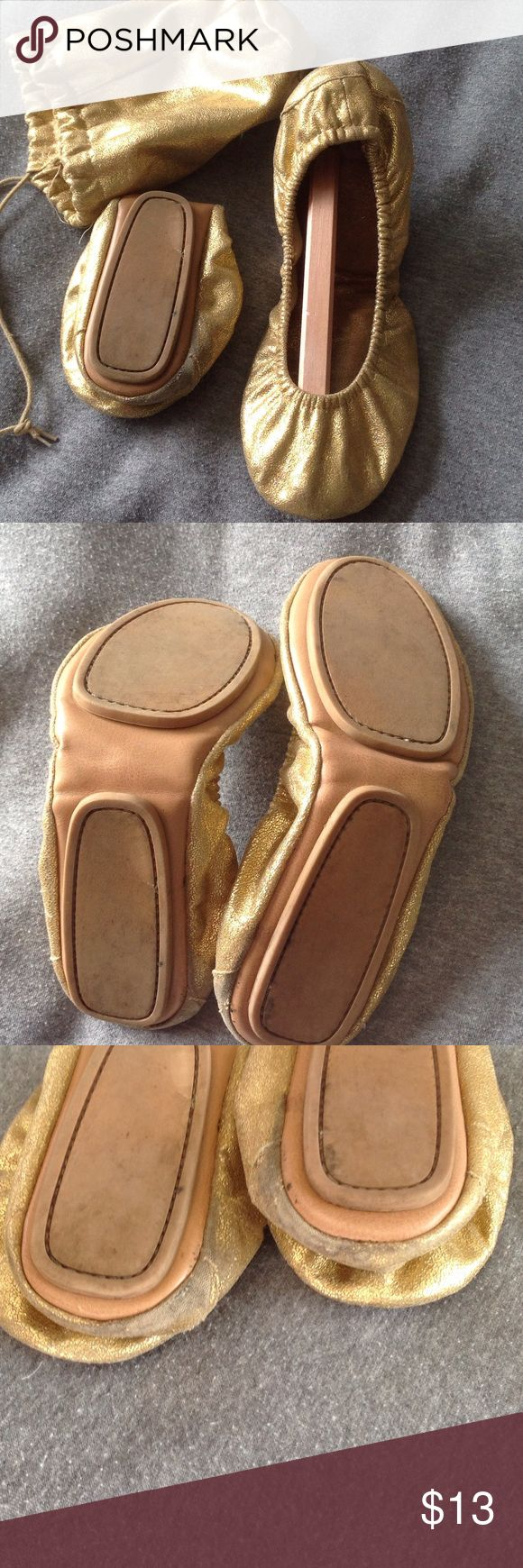 Gold ballet shoes Folds into pouch. Distressed gold color. Slight wear on heels as pictured. Comes w pouch. Great for long nights out. Shoes Flats & Loafers