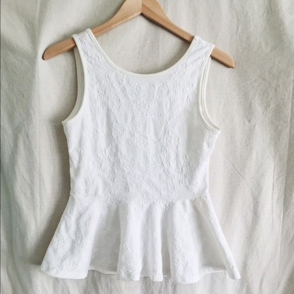 White peplum top White peplum top with lower back and embossed detailing all over. Worn and washed  once. Nice thick material. Size medium Tops Tank Tops