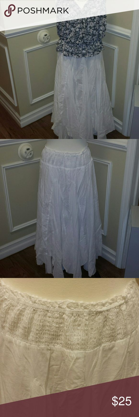 Summer maxi skirt White maxi skirt perfect for summer with smocked waistband.  pure 100% cotton voile. Had uneven raw hem, very boho chick. Wore only once  no rips holes or stains,  no inside tag but was a large. Waist 15 in across unstretched but can easily stretch much more sick it's puckered and smocked at the waist. Skirts Maxi