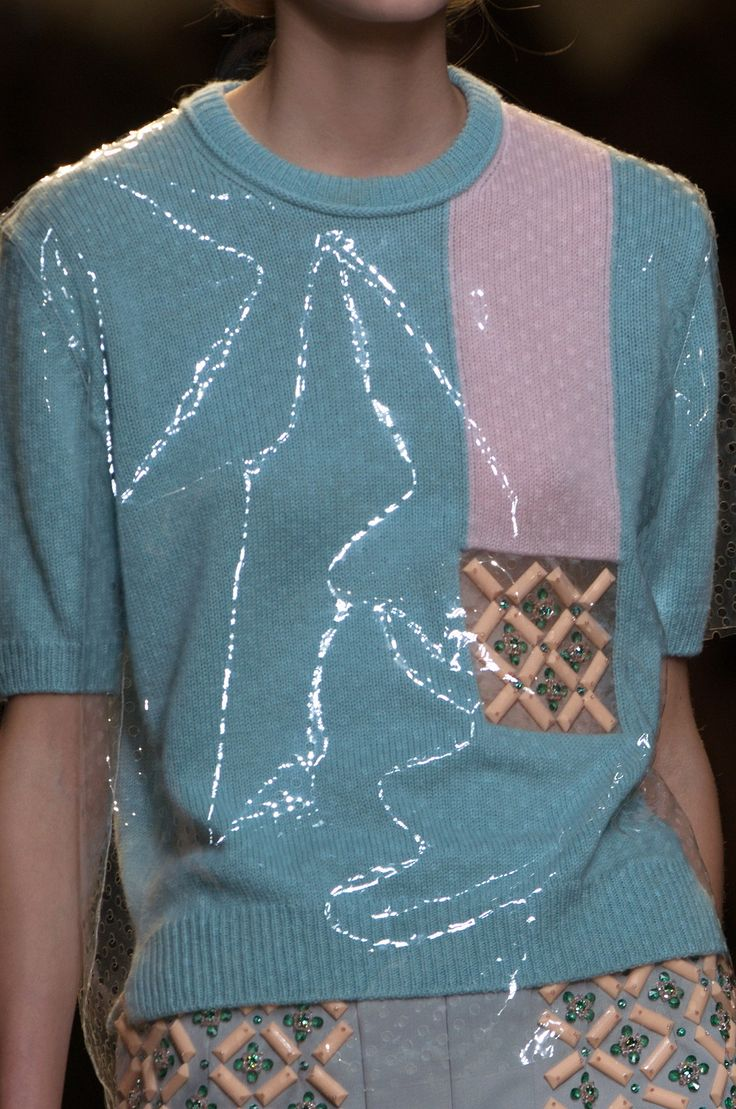 Designer @Fendi innovates summer knits with coated plastic for a squeaky clean finish. #MFW #SS15