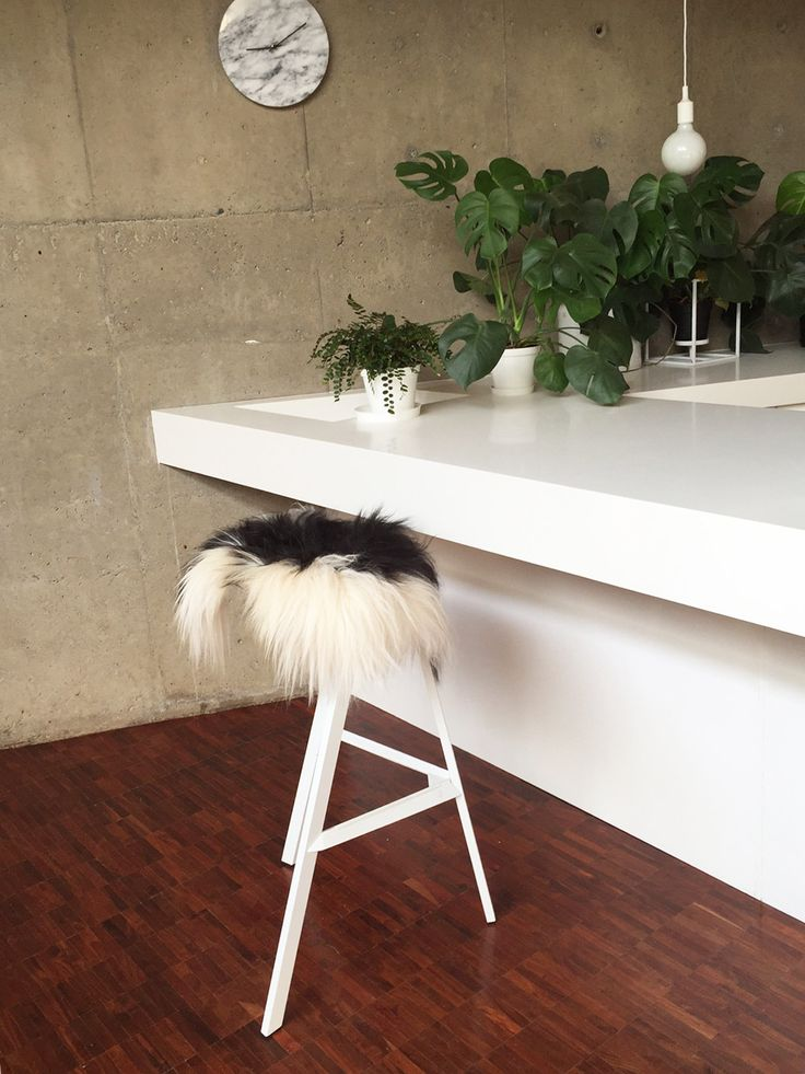 Those once stark kitchen bar stools have transformed into luxurious Scandinavian style stools with baaa's Natural Spotted Icelandic Sheepskin pad.
