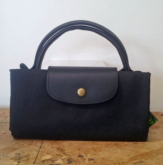 Fold up travel bag, luggage or extra suitcase made for waxed cotton and leather.
