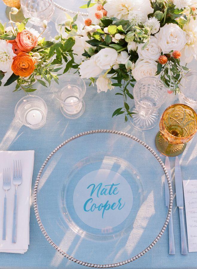 Elegant wedding table decor: http://www.stylemepretty.com/2016/02/26/elegant-seaside-wedding-with-a-pop-of-orange/ Photography: Joel Serrato - http://joelserrato.com/  #placecard
