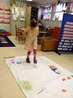 """Great idea for fairy tales! Using white butcher paper, the teacher wrote """"Once up a time"""" at the beginning of the sheet, and """"The end"""" at the end. Kids drew and wrote a story in between:)"""