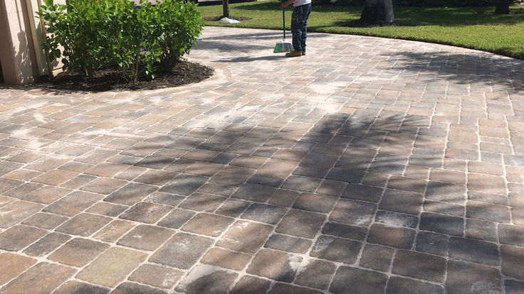 Best way painting employees filling in driveway paver