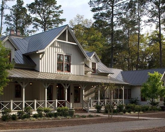 now that's a PORCH! board & batten siding with metal roof is my favorite  love the trim on the beams holding up the roof and the x's on the railing
