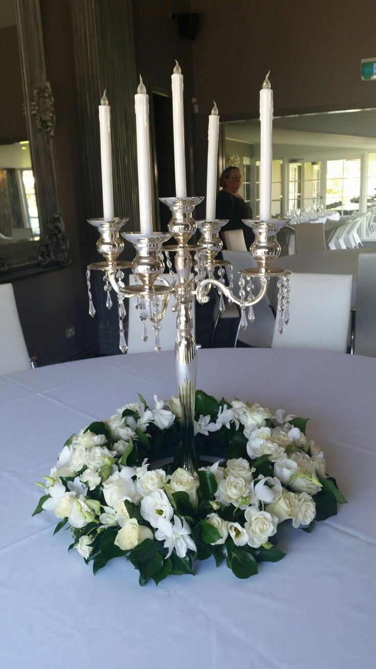 Candelabra decorated with wreath of roses lissianthus n orchids