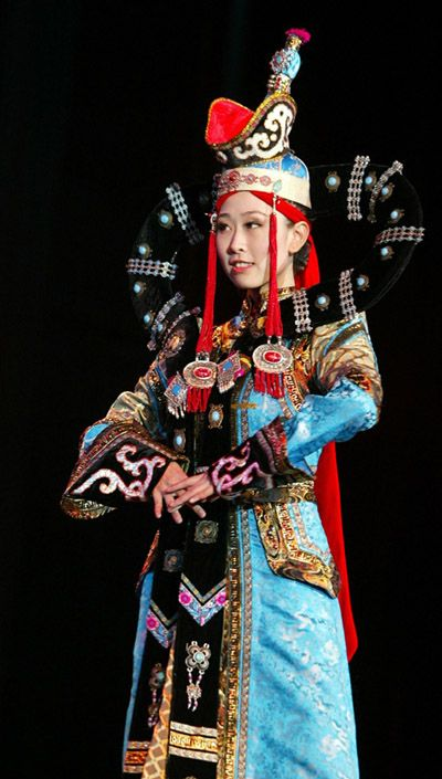 traditional costumes of a Chinese ethnic group in a Chinese Ethnic Costume Tour Display held in Rome