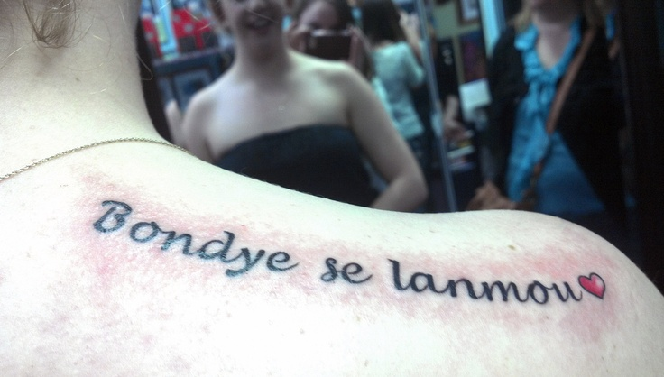 """This woman's tattoo saying God is love"""" in creole is FABULOUS! I love it soo much <3     If I ever get a tattoo it will say, """"Kè m 'se an Ayiti."""" meaning my heart is in Haiti <3"""