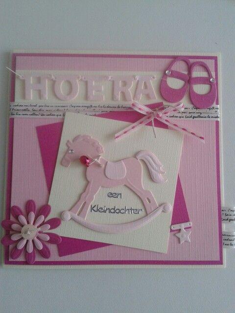 Hoera een kleindochter met hobbelpaard.lint.bloemen.knoopjes.schoentjes en letters aan elkaar gestikt met naaigaren.