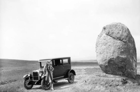 It's unusual to find a photo of Los Angeles—even a vintage one—with only one person and no buildings in it, so this is a rare gem. The woman and her Chevrolet are admiring what will come to be known as Founders Rock, which was a boulder set into place in 1926 to mark the dedication of the University of California Los Angeles's Westwood campus. Yes, that's right, all that vast empty countryside is now the sprawling campus of UCLA.