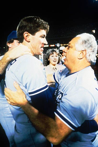 Orel Hershiser of the Los Angeles Dodgers hugs his manager Tommy Lasorda after the Dodgers defeated the Oakland Athletics in Game 5 of the 1988 World...