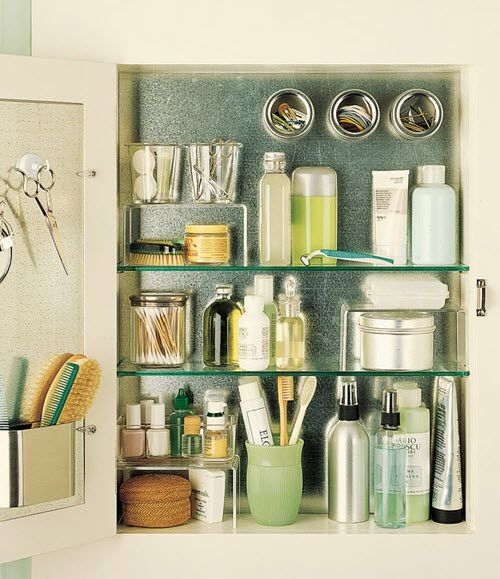 love the tin in the back of a medicine cabinet, magnets, acrylic risers, and door organization!