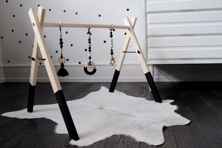 Black Wooden Baby Activity Gym - Wooden Play Gym, Wood Play Gym, Baby Play Gym, Baby Activity Gym, Play Gym, Play Gym Toys, Baby Shower Gift by SweetiePieDesignCo on Etsy https://www.etsy.com/ca/listing/497820094/black-wooden-baby-activity-gym-wooden