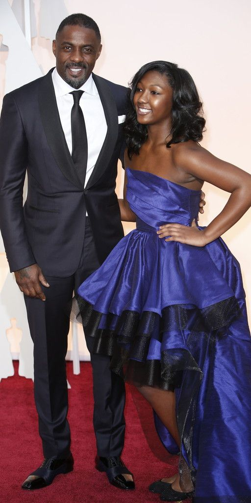 #oscarfashion FEBRUARY 22, 2015 Idris Elba and Isan Elba.  Noel West for The New York Times
