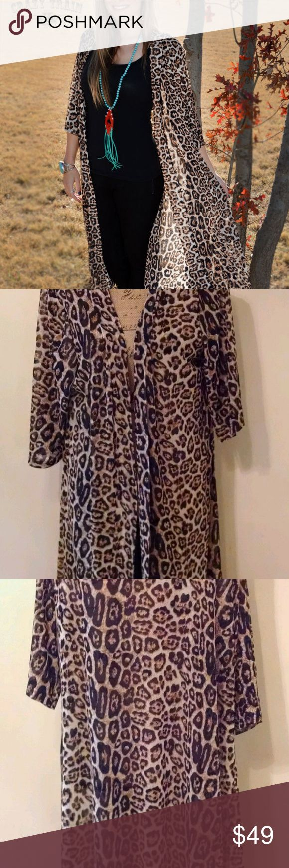 "Crazy Train Clothing Dixie Duster Long Sm-Large Crazy Train Clothing Dixie Duster Long Cheetah Southwestern Boho Sizes Small-Large  Boho, Southwestern style. Sheer, however heavier fabric. Long Southwestern boho style.  Please pay close attention to measurements rather than size. Sizing may not be ""typical"" of standard sizing. Laid flat-Chest (armpit to armpit) Chest 17"", Sleeves 18"", Length 42""  We are an authorized retailer of Crazy Train items. If you don't find it in our store, we will…"