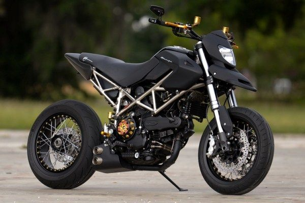 Check out this beautiful 2008 Ducati Hypermotard customized by C2Design of Tampa, Florida. Check out this flat black Hypermotard with Kineo spoked wheels.