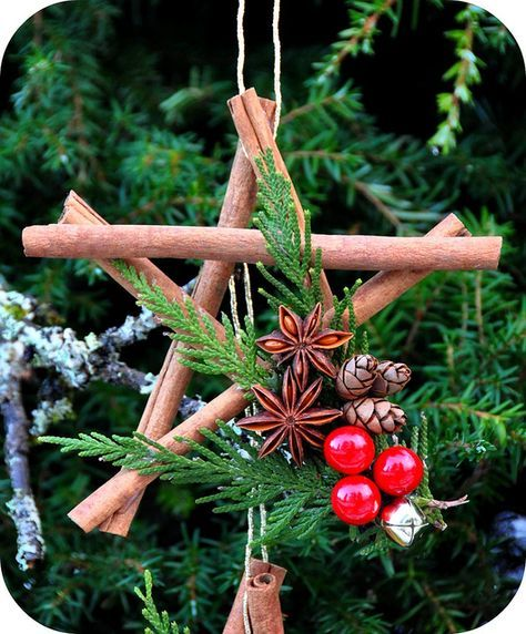 Christmas DIY Ornament: Cinnamon stick (or twig), cedar branch, miniature pine cone, bell and red berry Christmas ornament. Very pretty.