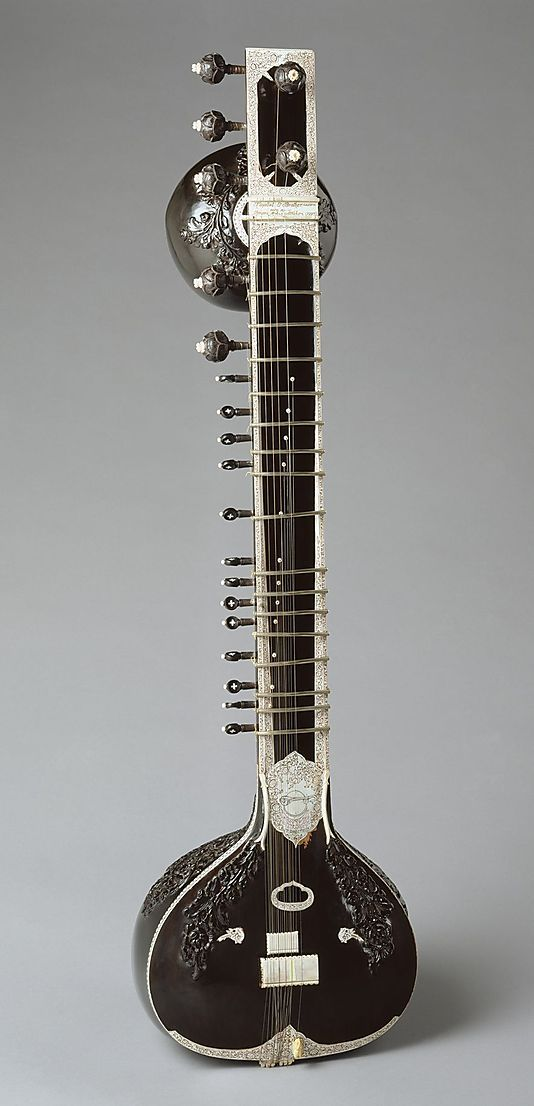 This sitar with 7 melody and 13 sympathetic strings was made in 1997 by Murari Adhikari, son of Nityananda Adhikari, an early 20th-century innovator of sitar construction. Murari continued to incorporate his father's improvements that included elaborate engraving and carving, rounded frets, a concave neck, changes in bridge design, and adjustments that produce an even tone from high to low.
