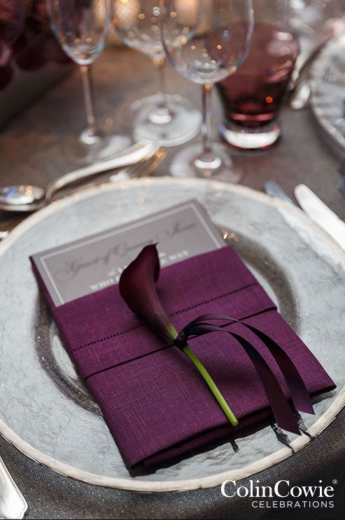 Single calla lily punctuate similat purple place settings for an elegant feel. Wedding Flowers, Wedding Décor
