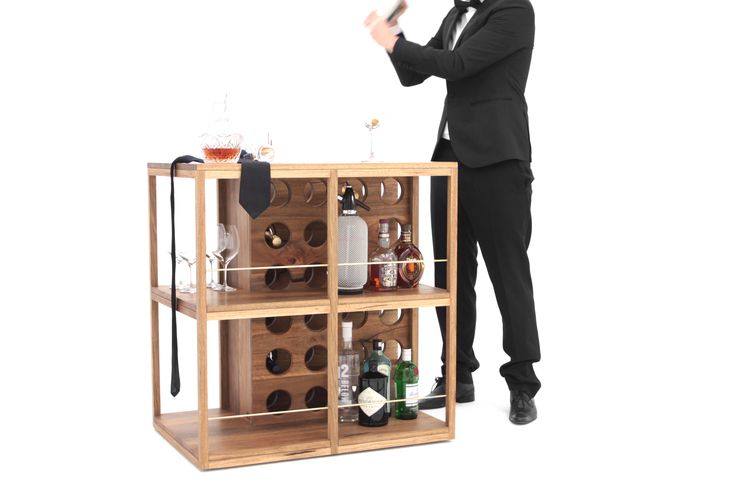 Plonk Bar is a drinks storage unit-meets-cocktail bar and wine rack. With styling out of the 1960s, it wouldn't look out of place in Don Draper's living room. The piece is mounted on concealed, recessed castors which allow for the bar to be easily rotated or moved - the ultimate mobile drinks station.   At 900mm high, it is the perfect height to mix cocktails, serve whiskey over ice or open a nice bottle of Chianti to let it breathe.   www.sawdustbureau.com
