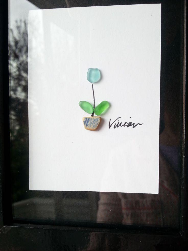 Genuine sea glass art tulip framed home decor wall art original by BeachenSea on Etsy https://www.etsy.com/listing/259587126/genuine-sea-glass-art-tulip-framed-home