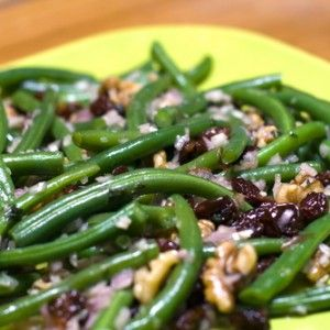Green beans contain only 44 calories per cup and they cook up to be crisp and flavorful. The cranberries and walnuts add sweetness, vitamins and nutrients, and omega-3 fatty acids.