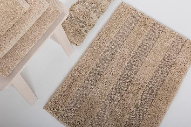 New Plus bath rug and batn towels.