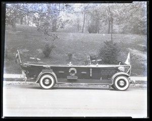 "The ""Budweiser"", a boat-shaped car used by Anheuser-Busch to promote their brand. The car has small cannons on the front and back, a life-preserver, a bouy, and several flags. Photograph taken by Sievers Studio in 1931. Sievers Studio Collection, Missouri History Museum."