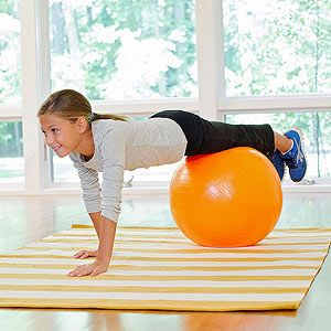 Hand-Walking the Plank: This more advanced move will enhance your child's balance as well as strengthen her upper body and core. Starting facedown with her chest on the ball, she slowly rolls forward until her palms are flat on the floor, then continues to walk her hands forward until her feet are on top of the ball and her body is in a push-up position (to spot her, hold her hips as she moves). From there, she slowly rolls back to her starting position. Work up to 3 sets of 5 to 10…