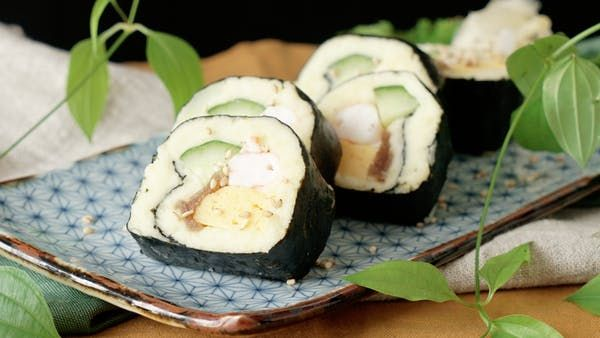 Recipe with video instructions: Instead of using rice, roll your shrimp sushi with wasabi-laced mashed potatoes for a rich and creamy twist. Ingredients: 200g potatoes, 1 tbsp sushi vinegar, 2 tbsp mayonnaise, 1/2 tsp wasabi, 1 sheet nori, 1/4 cucumber, cut into one long stick, 3 boiled shrimp, water, 1 tsp sake, 4 blocks egg omelette, 4 cooked and seasoned kanpyo (squash gourd shavings), sesame seeds
