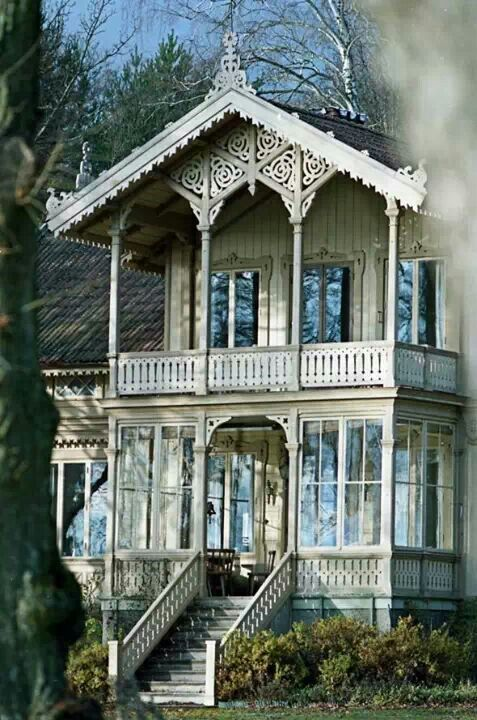 Quite ornate trim - lovely large windows and roomy porches.