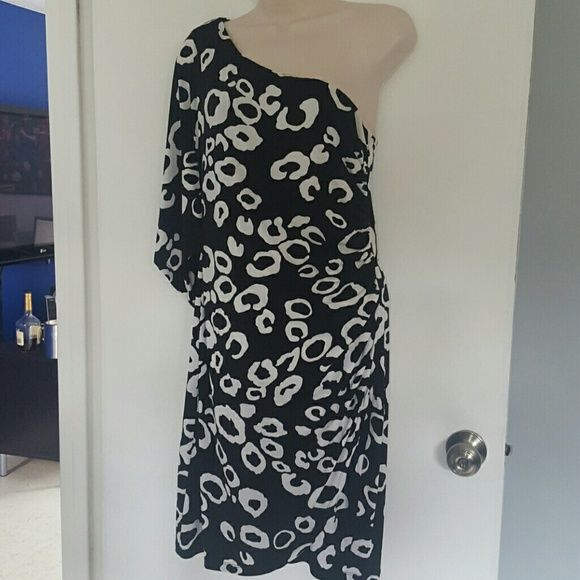 Valerie Bertonelli one shouldered dress Excellent condition. Worn twice.  Ruching in the front.  This dress is form fittig. Very flattering. Made of stretchy material. Size 8 valerie bertonelli Dresses One Shoulder