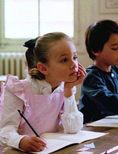 Sweet little girl in pink.... daydreaming in class.