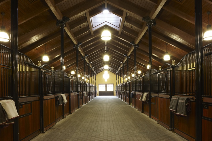 Dreaming Creek Timber | Lucas Equine horse stalls. | love the brick pavers, finials, and skylights... Though, i think i would make the entire aisle skylights.