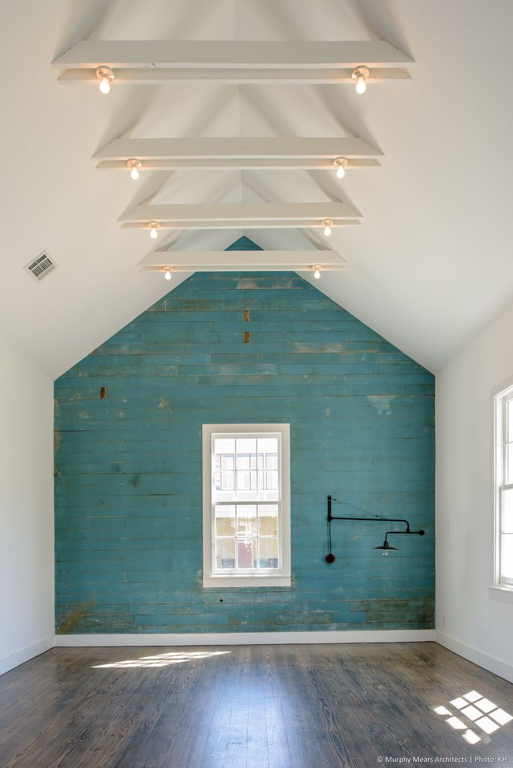 Renovated interior of the 1870's Gottlieb Eisele house, with the original end-wall finish revealed and the ceilings newly opened up.