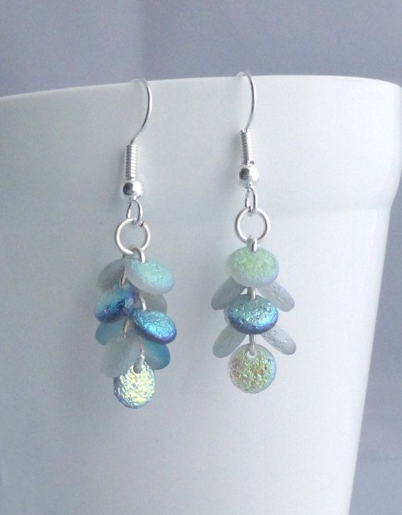 Gorgeous iridescent dangle earrings that remind me of mermaid tails and dragon scales. These pretty colourful earrings really catch the light as they move! They are made from beautiful etched glass lentil shaped beads which shine in blues and greens They are around 2cm long measured from the bottom of the earwire, so perfect if you prefer smaller jewellery. I have added the option of either silver plated or sterling silver earwires. These would make a lovely gift for a mermaid or dragon…