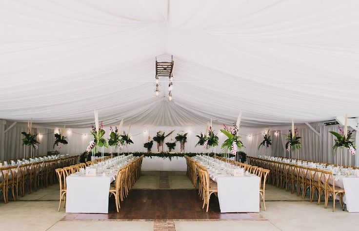 Hanging florals, crisp tables and wooden chairs.
