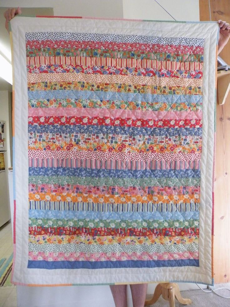 She used a jelly roll to make this quilt! I LOVE the pieced binding, too. Super duper simple!!