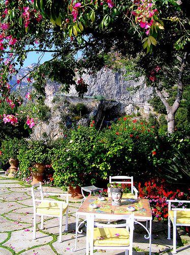 Terrace area at Il San Pietro di Positano hotel with the coastal cliff road in the background - Italy via flickr