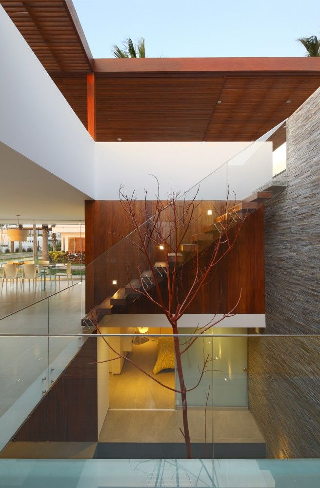 Minimalist House // love the use of wood and glass at the Casa P12 by Martin Dulanto