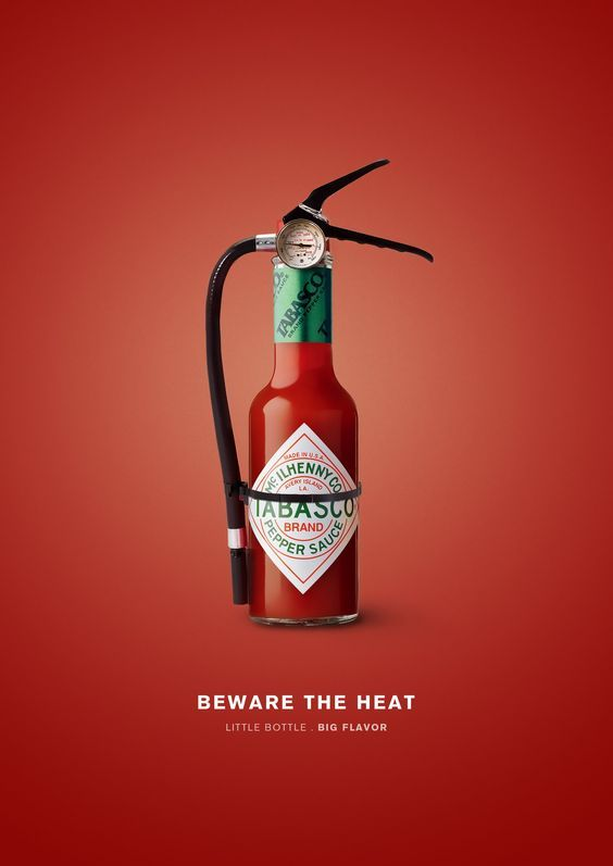 2. Image – There is only one image in this advertisement and it portrays Tabasco sauce as a fire extinguisher as well with the words 'Beware the Heat'. Thus, it is trying to imply that Tabasco sauce can be really spicy and hot that only a fire extinguisher can put the heat out.