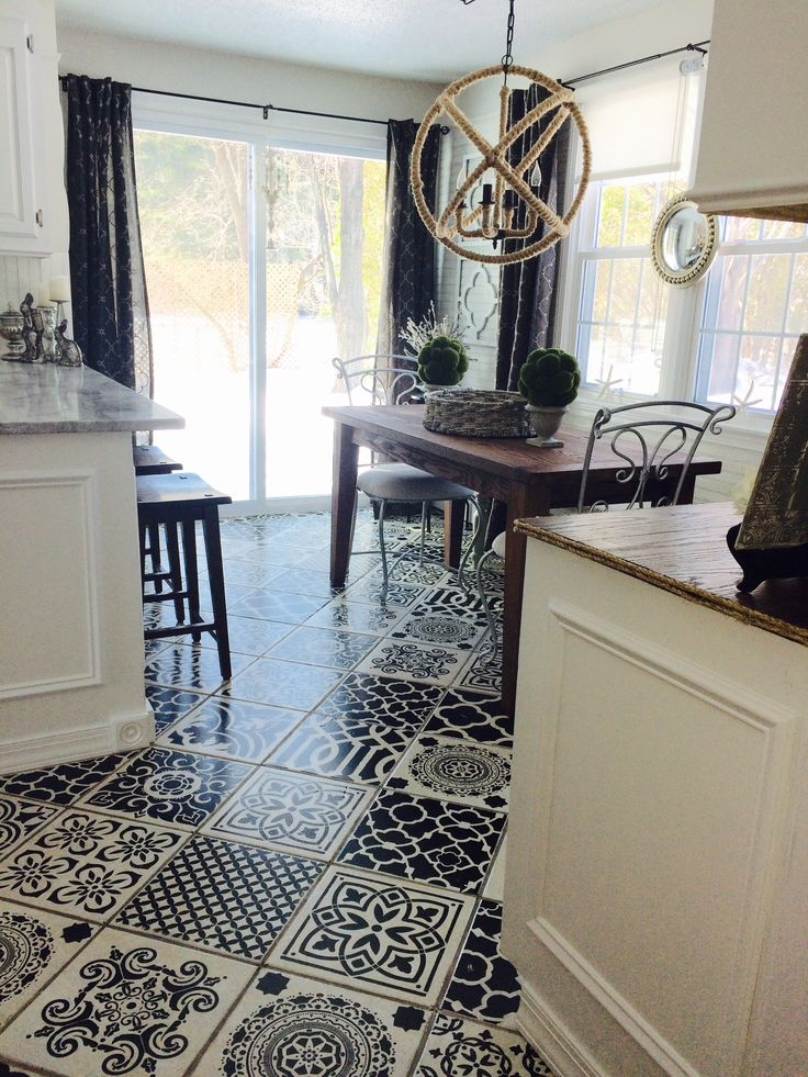 This is my completed floor project in my kitchen where I stenciled my existing ceramic tiles with porch paint and three coats of heavy duty formula Varathane in a satin finish. You too can get the look of the expensive encaustic cement tiles for less than $200.00. I used different stencils from Cutting edge stencils (purchased online) and some from Michaels. Create your own patterns or even one stencil style looks amazing!
