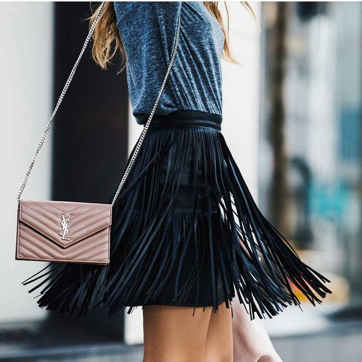 Dancing the night away in this swoon worthy fringe skirt.