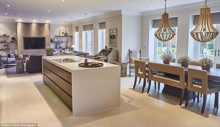 Sophie, who has a plethora of celebrity clients, opened the door to her own Surrey mansion, which is complete with a rustic, country-inspired kitchen. The decor  is a mix of soft neutrals, clean lines and natural textures