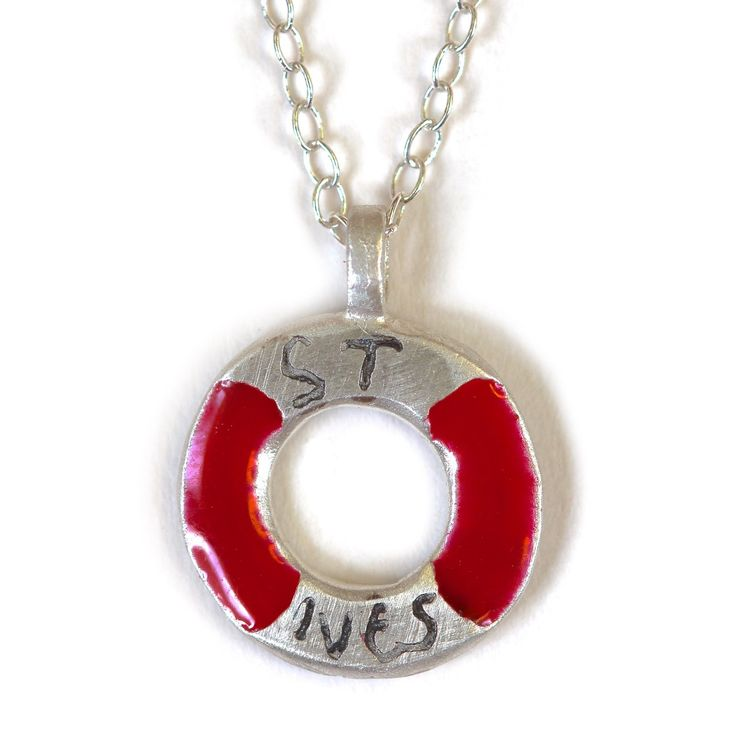 St Ives lifebuoy charm necklace Hello buoys! The perfect addition to a stripy top, our St Ives charm necklace is sure to remind you of the seaside, even if you're a long way away. In solid silver with engraved and bright red enamel details. Hand crafted in Cornwall by Justin Duance for Poppy Treffry.